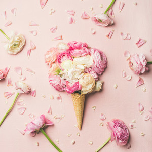 Waffle cone with pink and white buttercup flowers