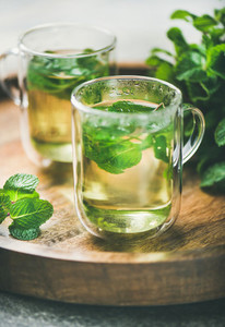 Hot herbal mint tea drink in glass mugs