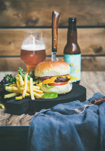 Classic burger dinner with beer and french fries copy space