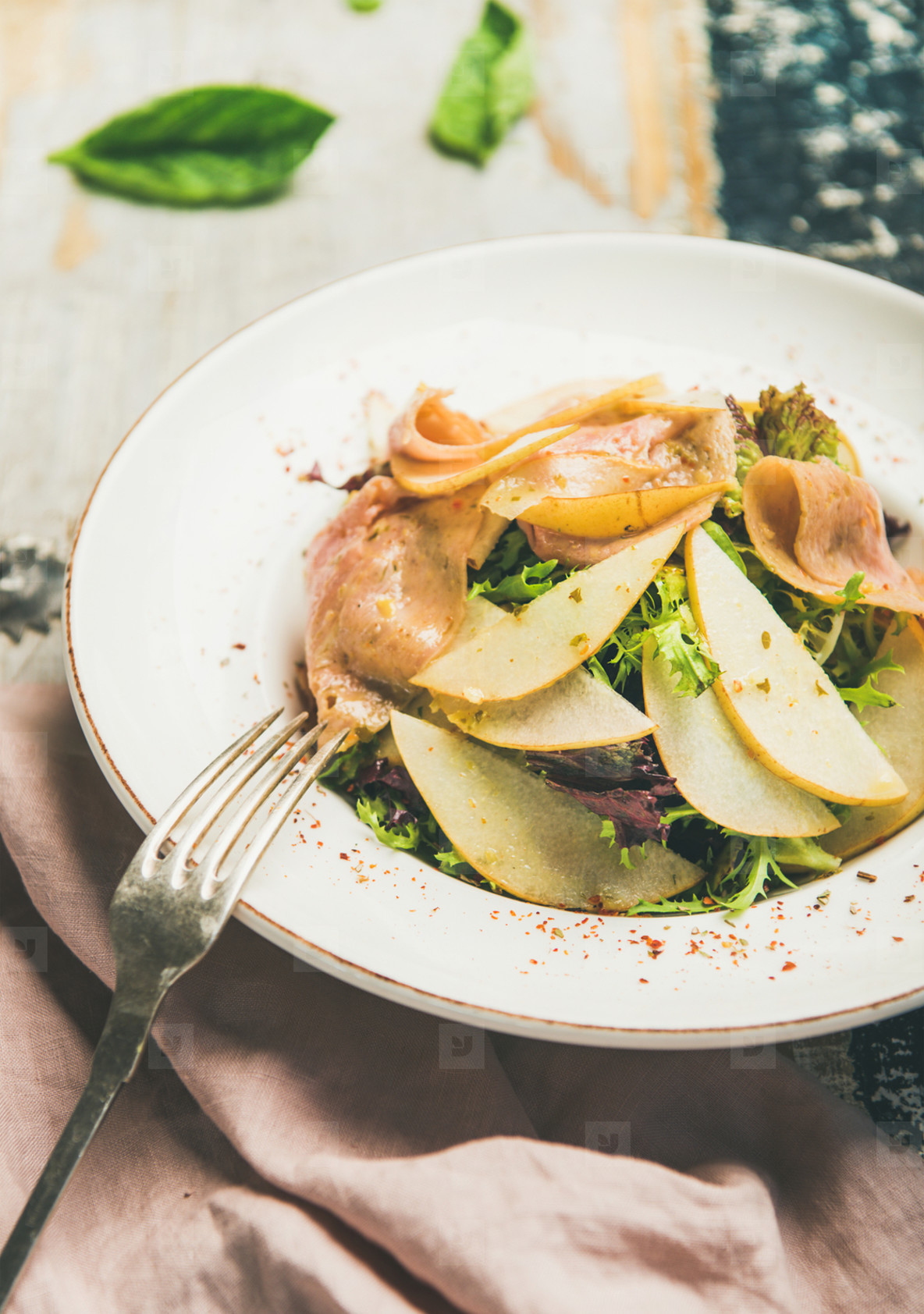 Summer fresh salad with smoked turkey ham and pear