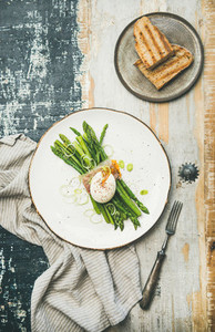 Healthy breakfast with green asparagus soft boiled egg  bacon and toasts