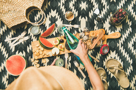 Summer beach picnic setting with charcuterie and fruits  copy space