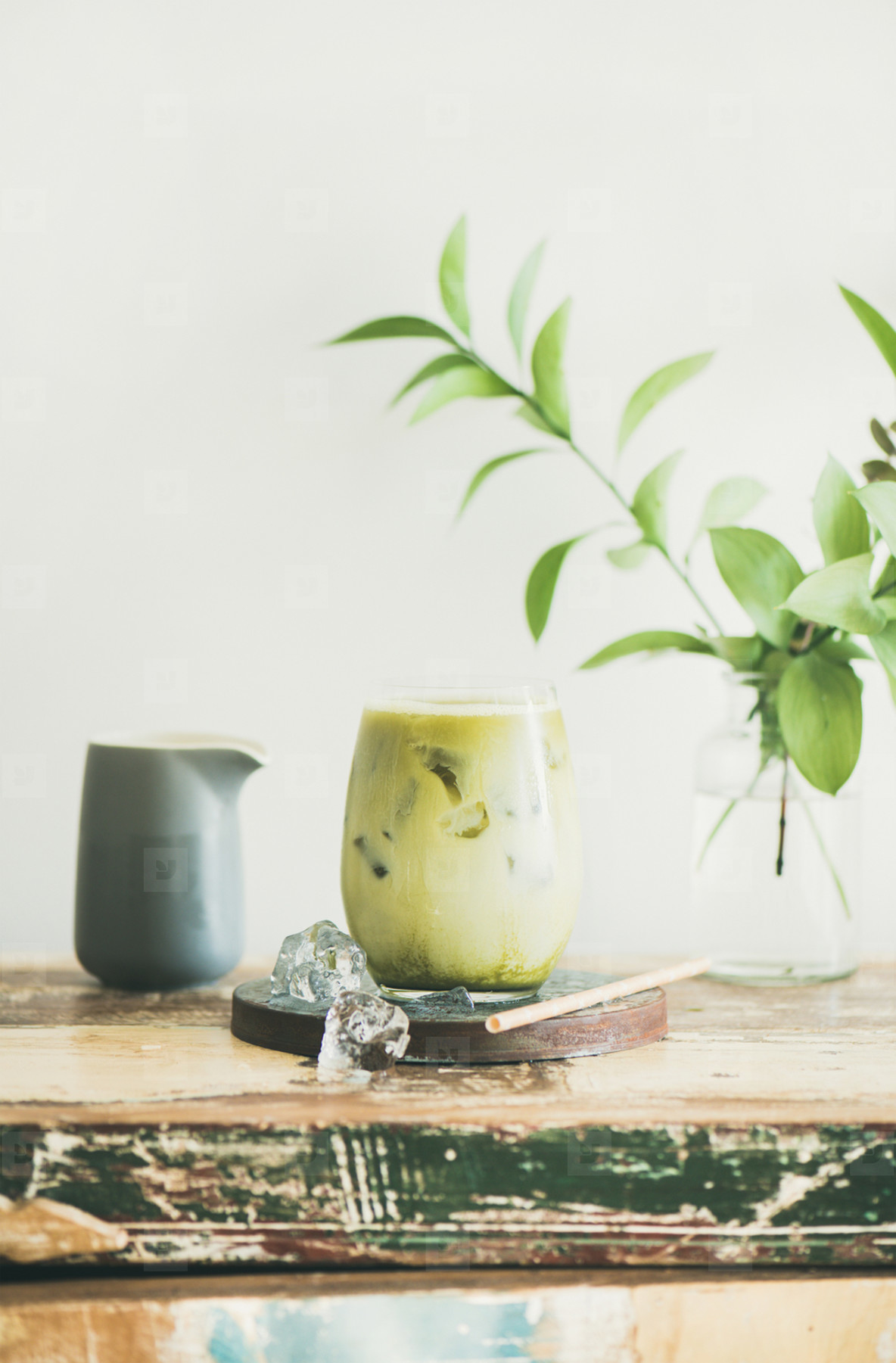 Iced matcha latte drink in glass  white wall at background