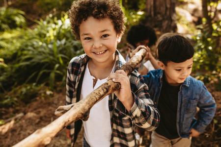 Children building camp in forest