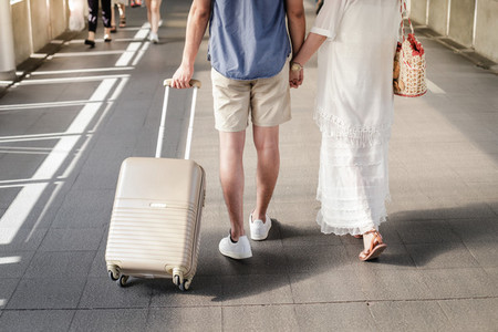asian traveler couple with suitcase