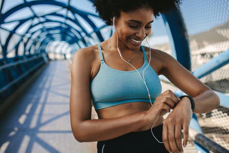 Female runner using smart watch