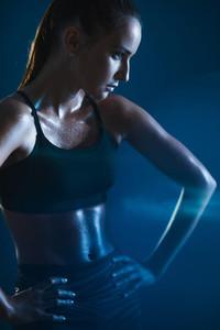 Female athlete with sweaty body