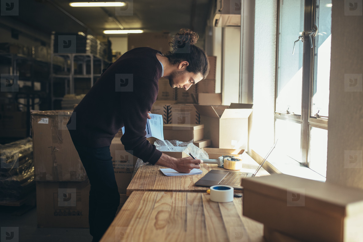 Man working in drop shipping office
