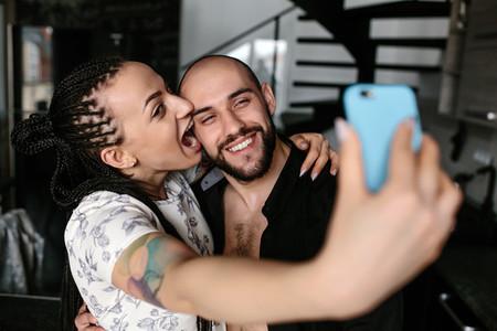 man and woman making selfie