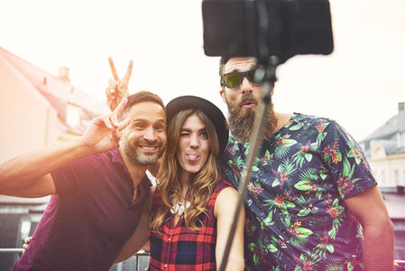 Man with beard and sunglasses makes bunny ears
