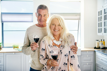 Cute middle aged couple with wine