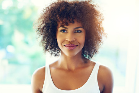 Grinning young black woman in sunshine