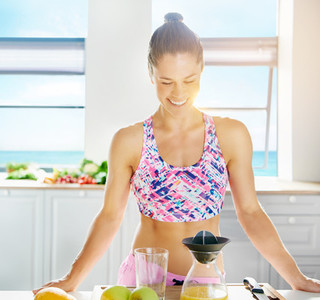 Gorgeous fit woman making fresh fruit juice