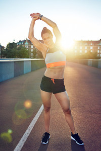 Fit young woman warming up before a workout