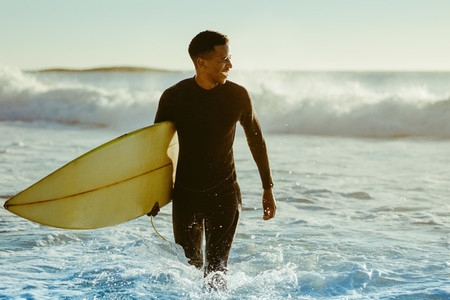 Surfer coming out of the ocean
