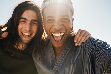 Excited two young men making a selfie