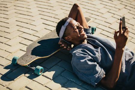 Skateboarder using smart phone