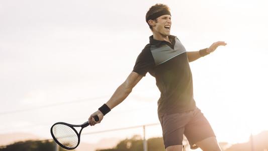 Professional tennis player hitting a forehand winner