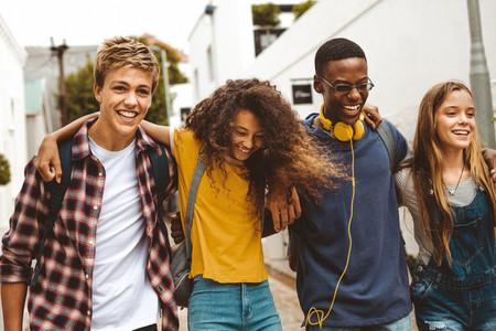 Cheerful teenage friends enjoying outdoors