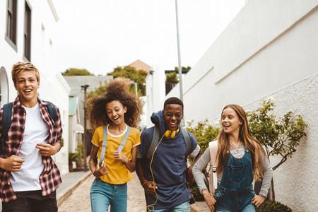Friends having fun walking in the street
