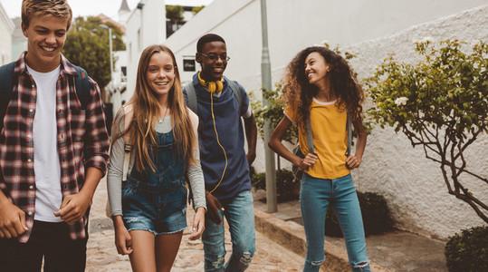 Teenage friends walking on street