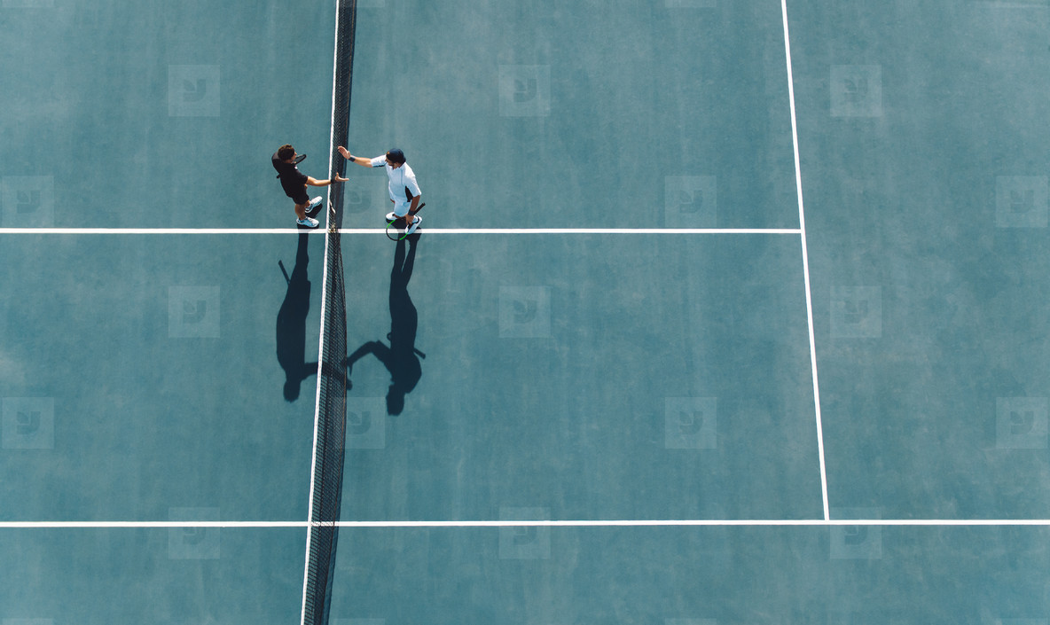 Professional tennis players handshakes after the match