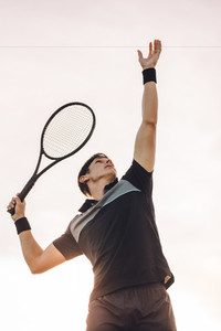 Professional tennis player serving