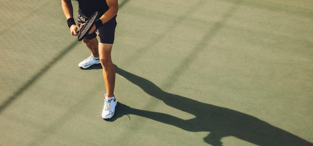 Tennis player playing tennis on hard court