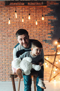 Dad and son on a background of a brick wall