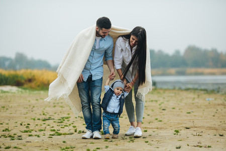 Young family with a little boy to have fun