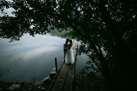 Wedding couple on the old wooden pier