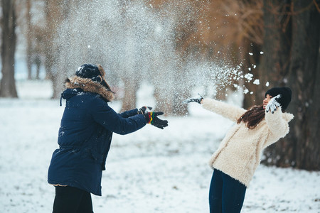 boy and girl playing with snow