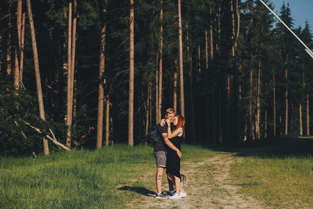 beautiful couple standing in a forest
