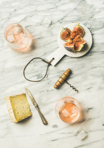 Glass of rose wine  fresh figs and cheese  top view