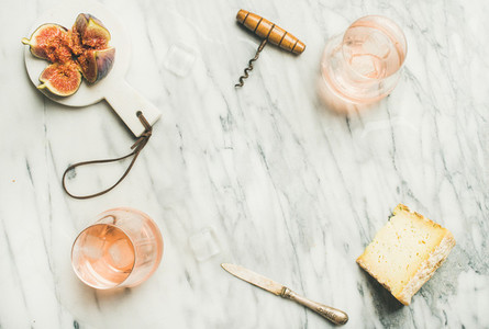 Glass of rose wine fresh figs and cheese copy space