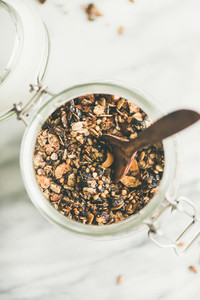 Buckwheat and granola with hazelnuts in jar with spoon