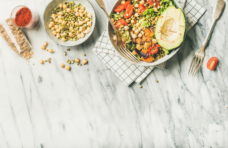 Vegan dinner bowl with avocado  grains  beans  vegetables  copy space