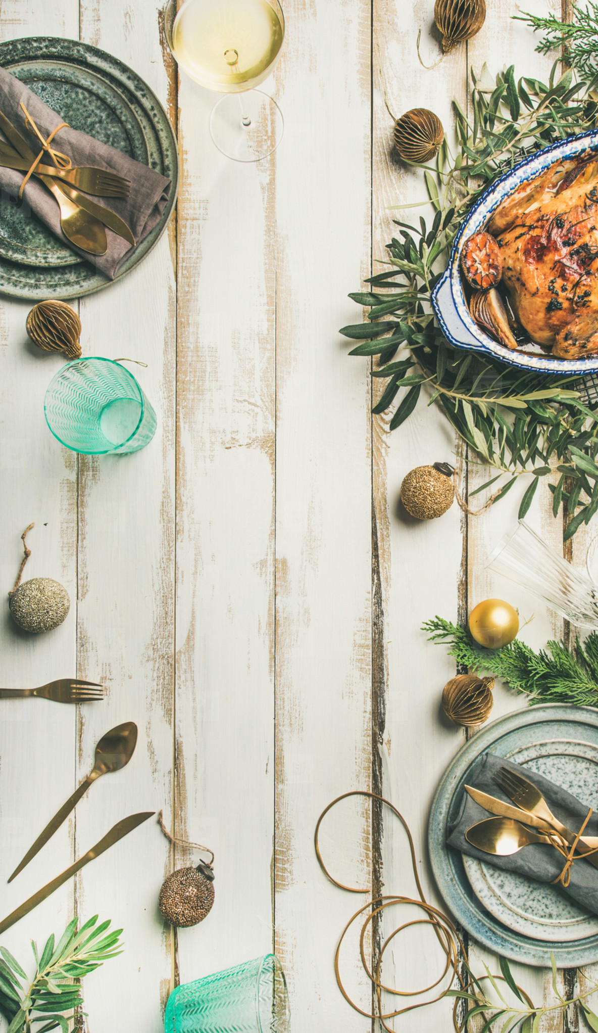 Christmas or New Year celebration table setting over wooden background
