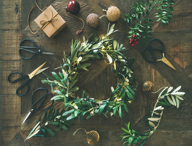 Flat lay of Christmas decoration toys and wreath