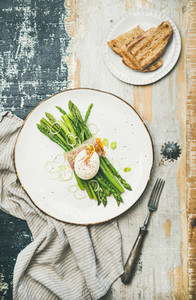Healthy breakfast with green asparagus soft boiled egg  bacon and bread