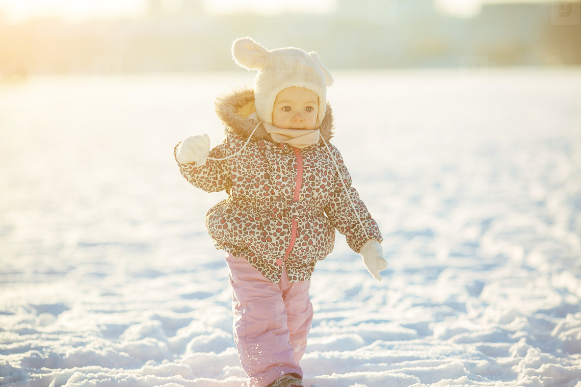 little girl walks in the snow
