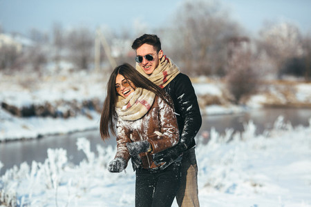 Happy couple in snow park