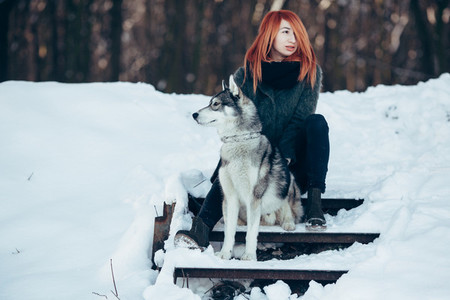 red haired girl with a dog