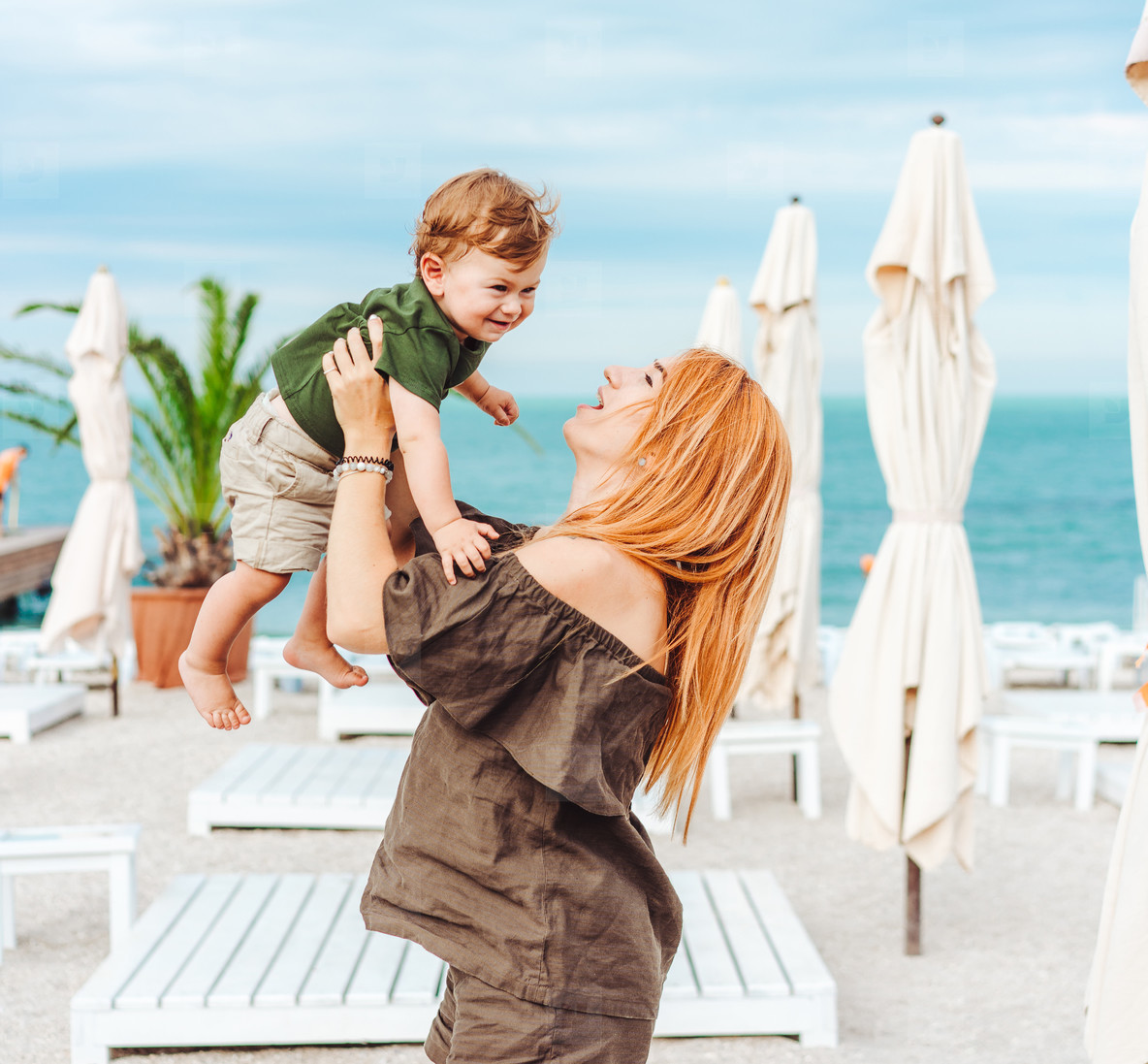 Mom and her little son on the beach  on vacation