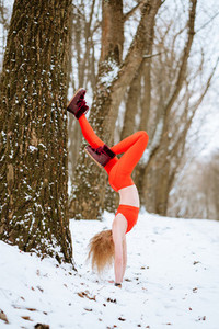 Fit woman warming up morning winter training