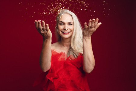 Mature woman having fun with glitters