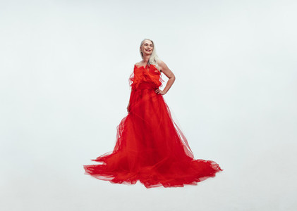 Beautiful senior woman in a glamarous red gown