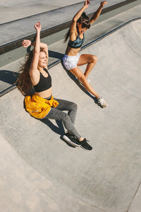 Friends in playful mood at skate park