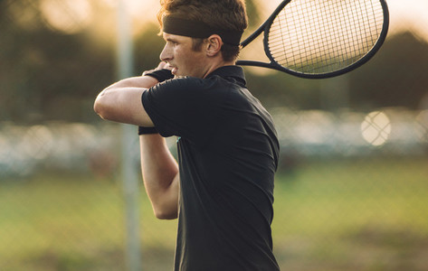 Tennis player practicing on a club court