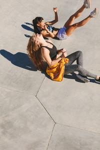 Women friends having fun at skate park